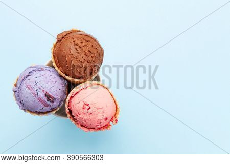 Berry, vanilla and chocolate ice cream sundae. Top view flat lay with copy space