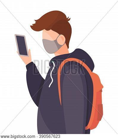 Young Man Wearing Face Medical Mask And Looks Into The Smartphone. Viral Pandemic. Coronavirus 2019-