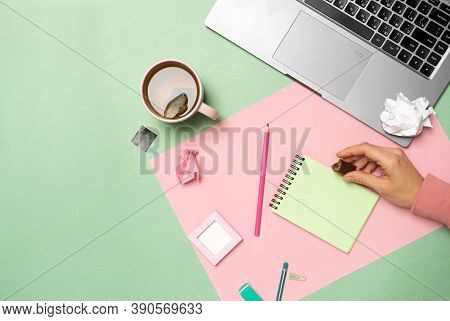 Woman Working With Modern Laptop, Took A Break To Drink A Cup Of Tea With Candy
