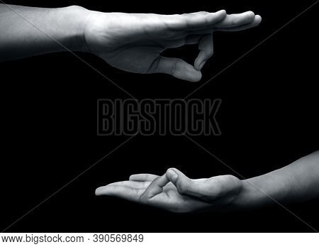Shot Of A Male Hand Demonstrating Jnana Mudra Or Wisdom Mudra Isolated On Black Background.