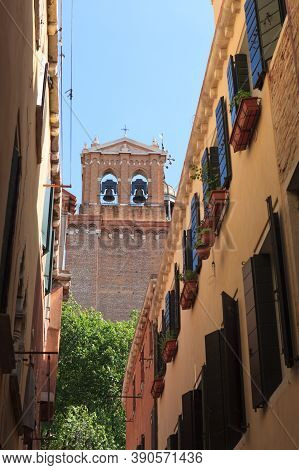 Narrow Street With View To A Belltower Of Chirch. Venice. Italia.