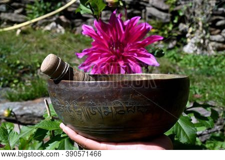 Tibetan Singing Bowl With Flowers. Translation Of Mantras. Transform Your Impure Body, Speech And Mi