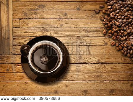 Cup Of Black Coffee And Roasted Beans On Old Weathered Wooden Plank Table Background, Top View