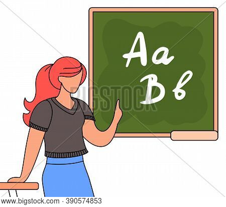Young Red-haired Woman Teacher With Ponytail Lean On Table Standing Near School Board, Gesturing Han