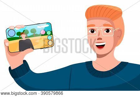 Male Young Character Tell About New Mobile Game, Shows The Smartphone With Depicting A Human Game Pe