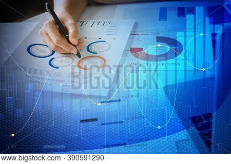 Close Up Hand Businesswoman Holding Pen And Pointing At Financial Paperwork And Planning Investment