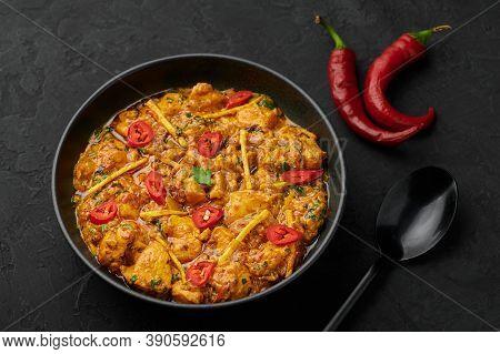 Chicken Handi In Black Bowl On Dark Slate Table Top. Murgh Chicken Is Indian Cuisine Curry Masala Di