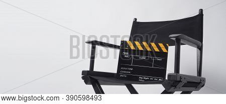 Director Chair With Black And Yellow Clapper Board Or Movie Slate On White Background.it Is Used In