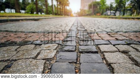 Traditional Color Stone Pavement In Perspective After The Rain. Abstract Background Of Old Cobblesto