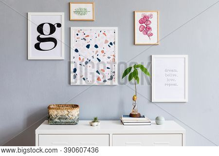 Stylish Interior Of Living Room With Mock Up Poster Gallery Frames, Furniture, Decoration, Plants An