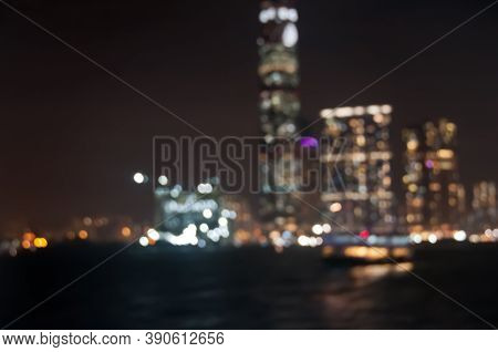 Blurry Defocused Night Scene Of Modern Skyscrapers Commercial District In Hong Kong At Victoria Bay