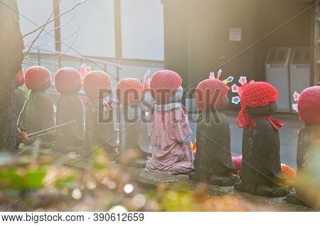 Tokyo, Japan - December 1, 2018: Scene Of Children Stone Sculptures In The Back Park Of  Zojo-ji Bud
