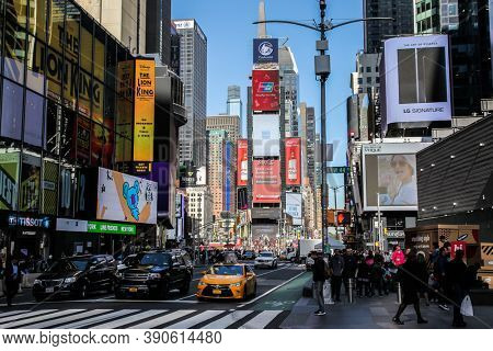 NEW YORK, NY, USA - OCTOBER 27, 2017. Busy Time Square with tourist and citizen in nice day seen from street.
