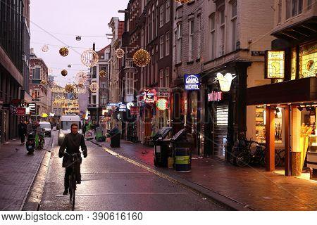 Amsterdam, Netherlands - December 6, 2018: People Visit Heiligeweg In Amsterdam, Netherlands. Amster