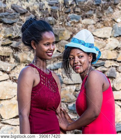 Gondar, Ethiopia - Feb 06, 2020: Young Girls Pose For A Portrait Taken At Fasil Ghebbi, The Remains