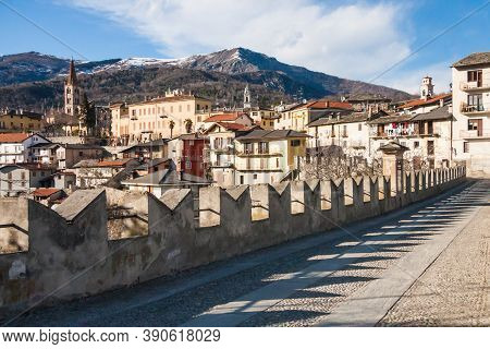 Scenic View Of Dronero Town With Snow On The Mountains In Cuneo Province, Piedmont, Italy From Ponte
