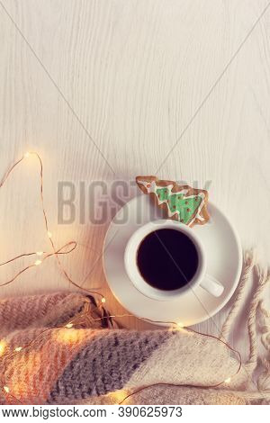 Mug With Espresso And Ginger Christmas Tree, Plaid And Light Garland On A Table Top View. Coffee In