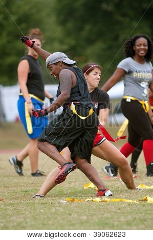 Young Women Collide Practicing Flag Football