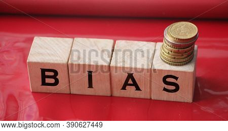 The Word Bias On Wooden Blocks On Red. Social Concept
