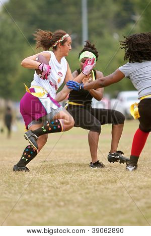 Female Flag Football Player Runs With Ball
