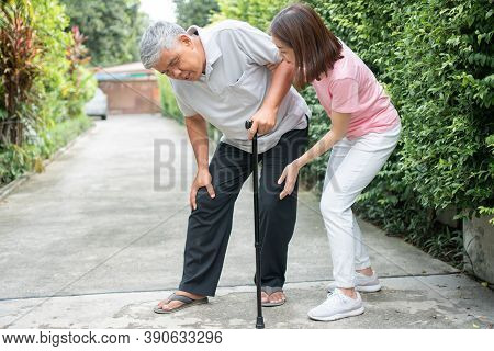 Asian Senior Man Walking In The Backyard And Painful Inflammation And Stiffness Of The Joints (arthr