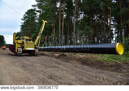 Natural Gas Pipeline Construction Work In Forest Area. Installation Of Gas And Crude Oil Pipes. Pipe