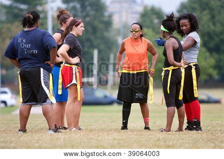 Female Flag Football Players Prepare For Next Play