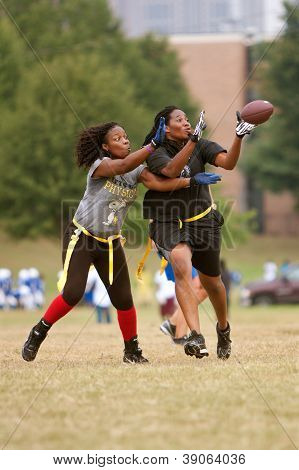 Female Flag Football Receiver Catches Pass