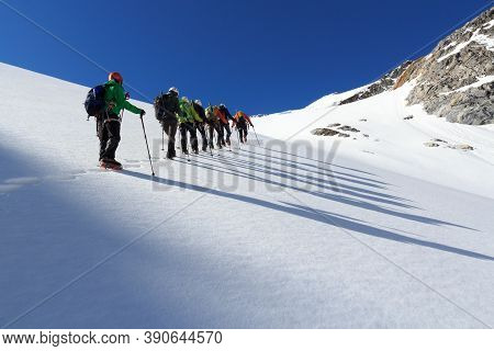 Rope Team Mountaineering With Crampons On Glacier Sexegertenferner Towards Sexegertenspitze And Moun