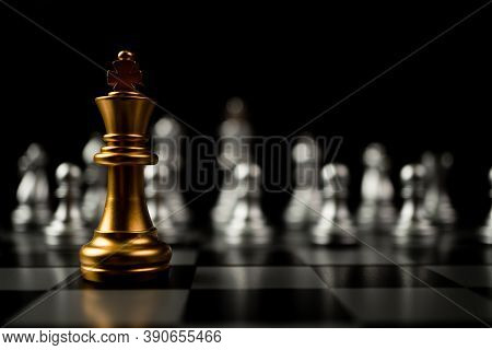 Golden King Chess Standing In Front Of Other Chess, Concept Of A Leader Must Have Courage And Challe