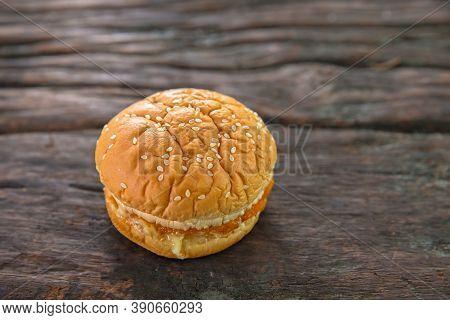 Thai Style Hamburger On An Old Wooden Table