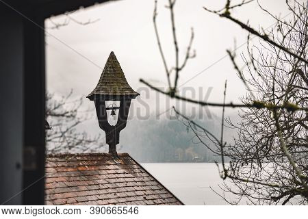 Rustic Garden Vintage Landmark View Of Chimney House Roof And Unfocused Bare Branches In Foggy Morni