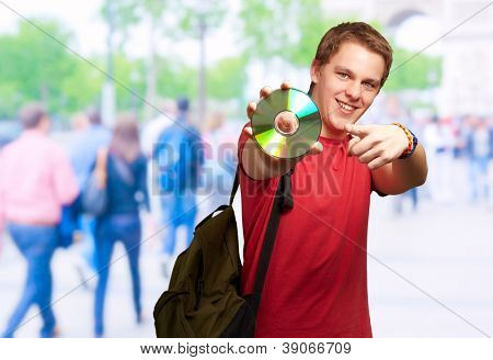 Happy Man Holding Compaq Disc, Outdoors