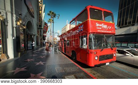 LOS ANGELES - Circa 2007: Double-decker tour bus at Hollywood Blvd. Walk Of Fame, Los Angeles, California