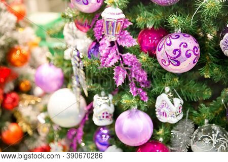 Close Up Of Colorful Ornaments On Christmas Tree. Happy New Year And Christmas. Bokeh Light Soft Eff