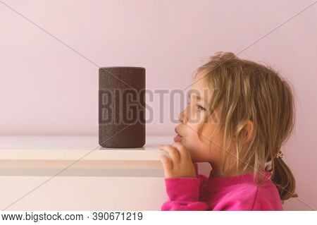 Voice Controlled Smart Speaker. Little Kid Girl Talking To Talking To Amazon Alexa Echo Dot. Educati