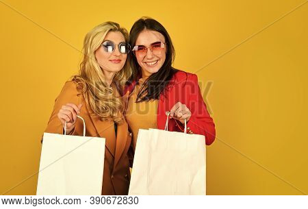 Black Friday. Women In Spring Jacket. Promoting Product. Girls Shopping. Shopping Mall. Luxury Bouti
