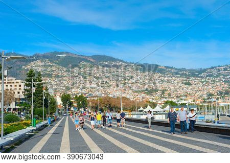 Funchal, Madeira Island, Portugal - Feb 04, 2020: Group Of People Walking By Embankment Of  Funchal.