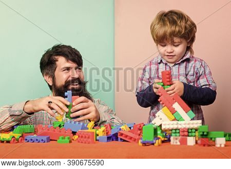 Father Son Game. Father And Son Create Colorful Constructions With Bricks. Bearded Father And Boy Pl