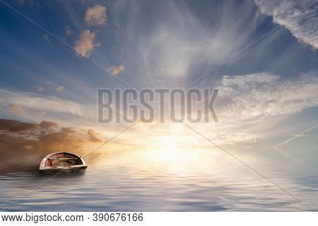 Lost At Sea, Old Rowing Boat Bobbing Around At Sea In A Tranquil Sunset With Calm Ocean Water. No La