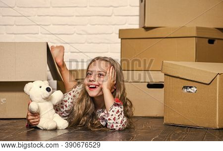 Girl Small Child And Boxes. Delivering Your Purchase. Dreaming About Own Room. Move Out Concept. Kid