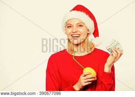 Symbol Of Wealth And Richness. Rich Girl With Lemon And Money. Girl Santa Hat Drink Juice Lemon Whil