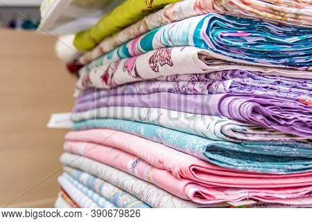 Fabrics In The Shop Window For Needlework.  Cotton, Calico Are In Rolls On The Shelf For Sale.