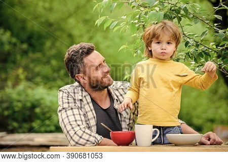 Summer Picnic. Morning Breakfast. Happy Fathers Day. Little Boy With Dad Eat Cereal. Healthy Food An