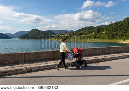 Young Mother Walking With Baby Carriage In Tara National Park In Serbia