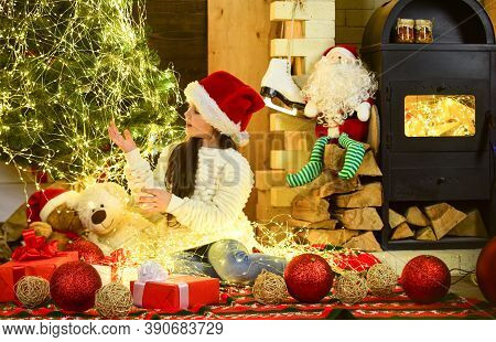 Led Lights Concept. String Lights. Indoor Garlands. Little Girl Relax Near Christmas Tree Decorated