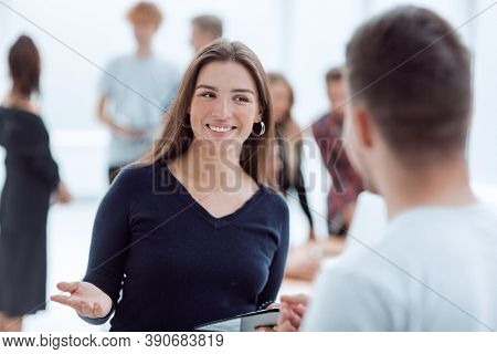 young business woman talking to her colleague