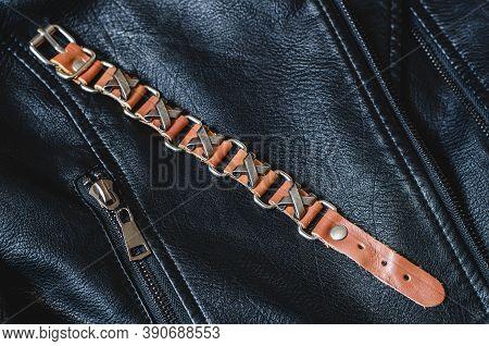 Stylish Brown Bracelet For Men On A Black Jacket. Beautiful Male Bracelet Close Up