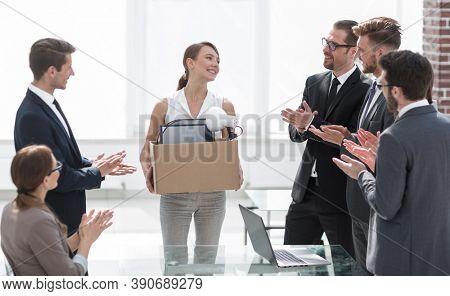 business team applauds the new employee