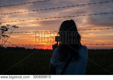 Girl Shooting On Phone Orange Hanging Curtains Of Smoke From A Large Wildfire And Obscuring A Firefi